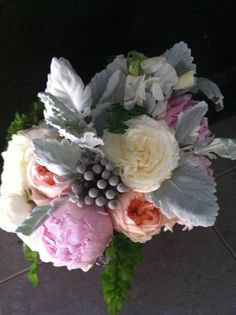 Loving the lavendar set against the soft coral, silver-green and berries.