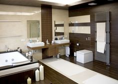 luxurious modern white bathroom with dark wood floors by Remodeleze, via Flickr