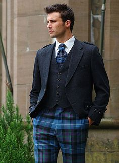 This gorgeous man is wearing trews, a traditional trouser which can be made from any family tartan. Fascinating bit of Scottish history!