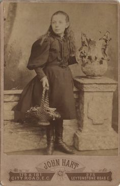 Cabinet photo of a victorian girl holding a basket taken in London around 1890s by John Hart (1838 - 1901) at his studio located at 179 & 181 City Road.