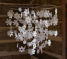 Sparkling snowflakes add winter wonder and ethereal style to kids' spaces. Paper snowflakes are laser-cut and finished with glitter. diameter, high A metal hoop with die-cut paper snowflakes sprinkled in glitter. Winter Christmas, All Things Christmas, Christmas Holidays, Christmas Room, Christmas Ideas, Crochet Snowflakes, Paper Snowflakes, Christmas Snowflakes, Snowflake Cutouts