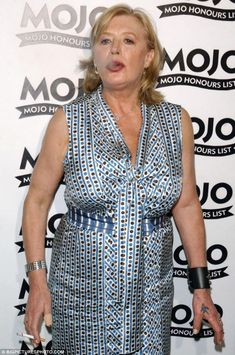 : Marianne Faithfull smokes a cigarette on the red carpet at the MOJO Honours List Award ceremony in 2004