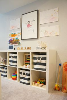 Chic Playroom Featuring Ikea Expedit Shelving Unit Filled With The  Container Store Rugby Stripe Bins, Toys Books, HomeGoods Trellis Box And  Restoration ...