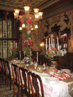 Dinning room table set for a Victorian reenactment group Christmas gathering in an 1897 mansion.