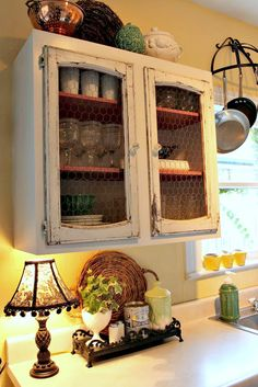love all of this ...lamp, cabinets and doors, tray, basket