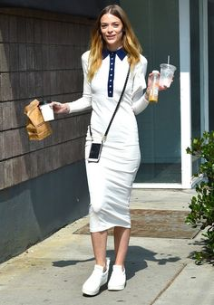 Jaime King pulls off a casual yet professional look by pairing a polo dress with platform slip on sneakers