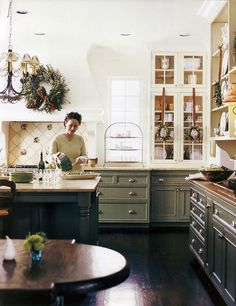 Kitchen with sage green base cabinets and white upper cabinets - Traditional Home, Holiday 2004