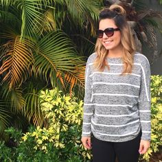 Seeing Stripes Sweater is the perfect outfit to wear all the time! Available in Small through 3XL and only $40! The gray material is super soft and stretchy and the white stripes are the perfect detail! If you love being comfy and casual (and maybe sipping champagne at the same time!) then this grey sweater is for you! Regular and Plus Size available!