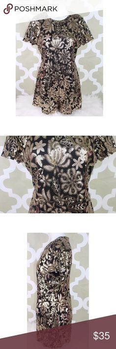 CALS Black Gold Floral Sequin Romper Shorts CALS Womens Black Gold Floral Sequin Romper Shorts Club Edgy Dance Sz L C4 •100% Polyester •Bust 19 Inches •Length 30 Inches •Waist 15 1/2 Inches •Inseam 2 Inches Cals Dresses Mini