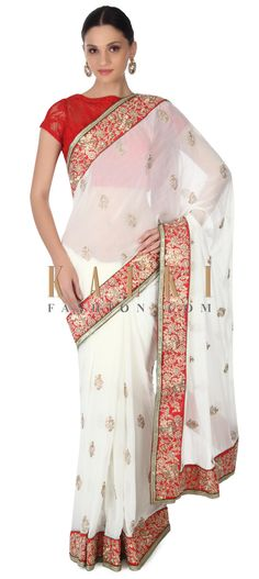 Buy this White saree adorn in zari and sequin embroidery only on Kalki
