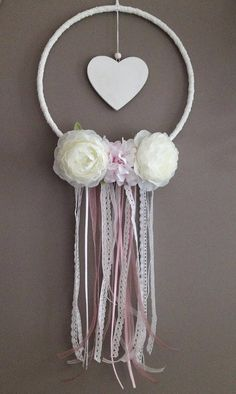 A dream catcher on the theme of love or marriage, romantic with its pink soft and white colors, its lace and ribbons, a white wooden heart and flowers fabric. Crafts To Sell, Diy And Crafts, Crafts For Kids, Teepee Party, Indian Arts And Crafts, Dream Catcher Craft, Chabby Chic, Angel Crafts, Yarn Crafts