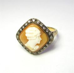 Shell Cameo Ring - A very detailed carving of a woman is complimented by a halo of diamonds. The ring is made from 18kt yellow gold and sterling silver. 115-A263 (subject to prior sale) – Lilliane's Jewelry – 4101 W. 83rd St. Prairie Village, KS 66208 – 913-383-3376 –