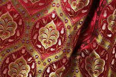 Ottoman: a fabric with a pronounced ribbed or corded effect, often made of silk or a mixture of cotton and other silk like yarns. It is mostly used for formal dress and in particular, legal dress (such as QC gowns) and academic dress (mostly for hoods).