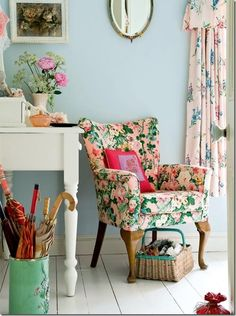 ~feminine sitting area~floral chair, floral curtains, white painted desk, powder blue walls, mint umbrella holder~