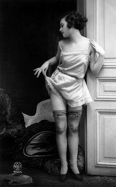 Vintageerotic postcard - model wearing cami-knickers.