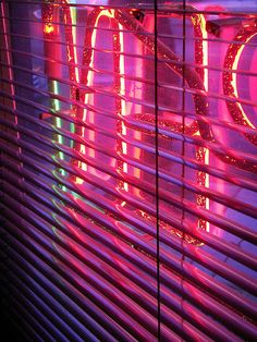 Behind the neon sign
