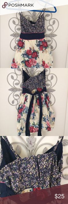 Exhilaration Small Floral Yellow Sundress Juniors This is made in Cambodia and has small spaghetti straps. It also has two different floral print fabrics. You can machine wash this. It's lined in cotton and made out of cotton as well. Dresses