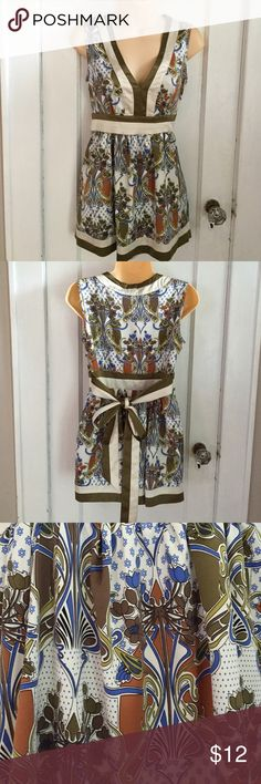 Nicole Miller beautiful blouse Nicole Miller beautiful blouse. Gently used. Side zipper and tie in back. Nicole by Nicole Miller Tops Tunics