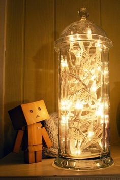 A different way to brighten up your room with string lights. --- this is similiar to what I already do with all my coloured glass vases :-) i should put pics up of those