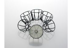 Repetition Flower bracelet, Jeehyun Chung, oxidised silver wire, Korean silk, metallic and invisible thread (photo: Kwang Choon Park)