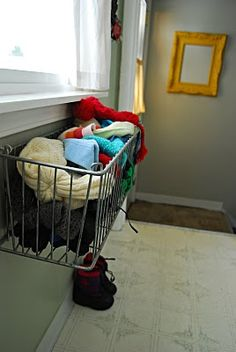 Use a window box on the inside of the house!  Mittens & hats, purse & library book, what else?