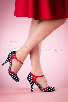 These 50s Hatty Polkadot T-Strap Pumps are playful vintage T-strap style pumps!  Simply too cute these pumps! A striking colour combination, sassy polkadots and a comfortable fit, that almost says enough doesn't it? Made from a dark blue fabric and finished off with lipstick red straps. Real cuties, right ladies?!    Adjustable ankle straps Round noses Silver toned buckle Anti-skid outsole
