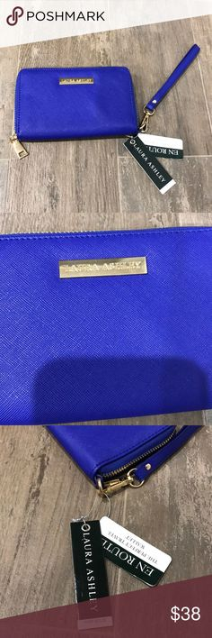 NWT Laura Scott travel wallet Blue Laura Scott travel wallet Blue. Zips shut, outside change zipper. 5 credit card slot, passport slot / or smart phone. Continent carry wristlet. Laura Ashley Bags Wallets