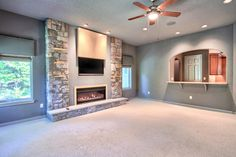 Amazing living room - Home features 3 story foyer, breathtaking master suite w/dual baths & walk-in closets, 4 FP's & an outdoor kitchen w/outdoor FP, exercise room, den plus a great room with bar. Home is located in Hershey PA and is available for purchase.
