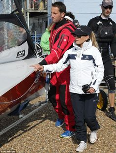Georgie Thompson assists Sir Ben Ainslie onboard love boat