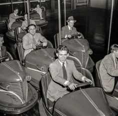 """""""Amusement park in Southington, Connecticut."""" Bumper cars and suits. May 1942. Photo by Fenno Jacobs."""