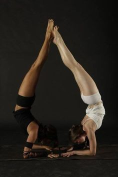 Now that's what I call partner yoga! Beautiful forearm stands on both sides.