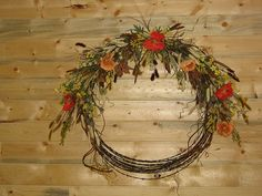 I love this idea. I have an old roll of barb wire that we found in the barn from years ago. Barb wire wreath made from natural surroundings.
