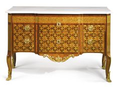LOUIS XV/XVI TRANSITIONAL ORMOLU-MOUNTED KINGWOOD AND AMARANTH STAINED SYCAMORE PARQUETRY AND MARQUETRY INLAID COMMODE CIRCA 1770