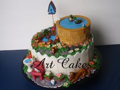 https://flic.kr/p/a6jqEZ | The Garden Cake | This cake was for a lady turning 80. She had a beautiful garden an a lots of animals. She had an open pool were the ducks come and swim, a small pond with turtoises, a big cage with lots of birds, a lizard, a ferrer, 3 dogs, 3 cats, and she likes to feed wild animals like racoons and squirrels. She got very emotional when she saw the cake.