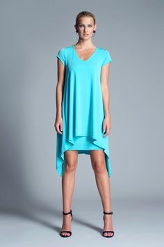 Irina Dress from Julian Chang. Easy and light v-neck dress featuring pointed hem. Lined with cap sleeves. $160