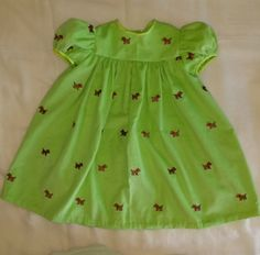 Scotties w/ Christmas red bows. Delightful dress w/  super puffed sleeves.