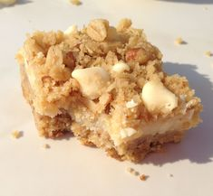 Streusel bars with white chocolate chips and a lemon filling that tastes a little like cheesecake. These are fantastic. #recipe #thegoldlininggirl