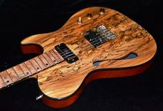 MJ Guitars, Duke Deville w spalted maple top. Made in Belgrade, MT.   I'm saving pennies for one of these with a clear-ish black finish.   http://mjguitars.com