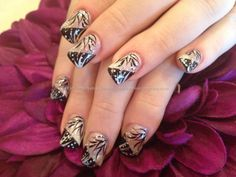 Acrylic nails with black and white freehand nail art