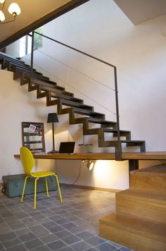 industrial style home office - built-in desk under open metal stairs