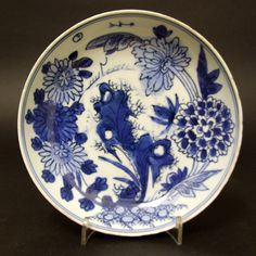 A Late Ming Porcelain, Tianqi 1621-1627 or Chongzhen Period 1628-1644, Blue and White Ko-Sometsuke Dish Made for the Japanese Market. Decorated with Peony, Lotus and other Flowers, the Base with an Apocryphal Ming Mark, a Six Character of Xuande 1426-1435. Ko-Sometsuke is a term used to describe Chinese blue and white porcelain made for Japan. This late Ming porcelain was made from the Wanli period (1573-1620) and ended in the Chongzhen period (1628-1644).