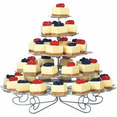 Wedding Food These fruit-topped cheesecake squares make a festive display on our Cupcakes ?N More Dessert Stand (sizes hold 13 to 38 servings). The size, one per table, makes a great centerpiece for weddings and baby showers. Cheesecake Wedding Cake, Wedding Cupcakes, Wedding Desserts, Mini Desserts, Individual Cheesecakes, Mini Cheesecakes, Individual Cakes, Cheesecake Squares, Cheesecake Bites