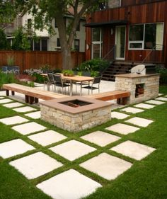 Outdoor seating area with fire pit, benches and square pavers.