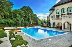 Large rectangular pool and stone patio