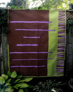 modern quilt with subdued colors: brown, purple, green