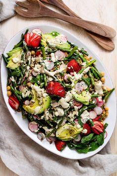 Spring farro salad. Upgrade your regular grain salad with spring vegetables and creamy, lemon tahini dressing. #farro #grainsalad #plantbased #vegan #gratefulgrazer