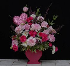 Lovely flower arrangement made in a heart shaped container from Rittners Floral School, Boston, MA  www.floralschool.com