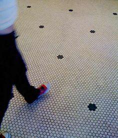 """white hex floors with black """"flower"""""""