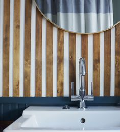 #slats are all the rage easy to do yourself, all you need is a nail gun, hand saw, and a level. Stain as desired. #bathroomdecor #slatwall #woodwall #bathroominspiration
