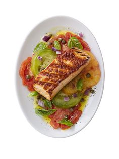 Grilled Salmon with Heirloom Tomatoes - This simple dish only takes 15 minutes to prepare and it's an easy way to get your omega-3's! For a complete meal serve with brown rice and a fruit and yogurt parfait for dessert. #myplate #protein #fruit